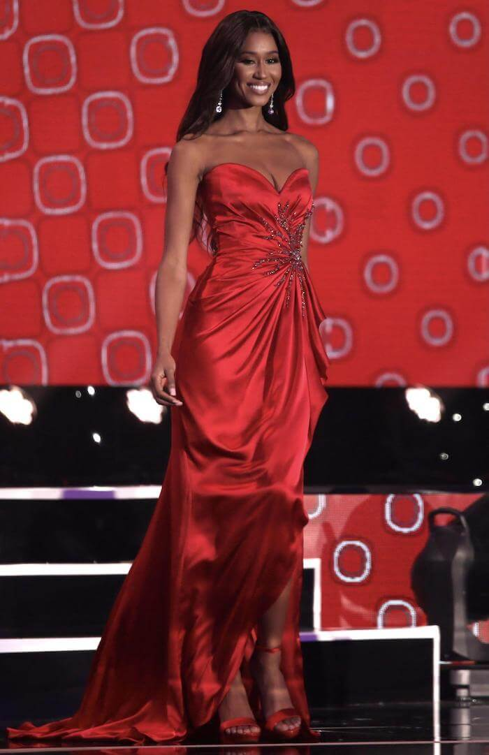 Andreia Gibau walks on-stage in a red Sherri Hill gown during the Miss USA Formal Wear competition. (by Jessielyn Palumbo)