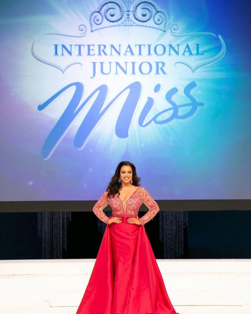 Claudia competing at International Junior Miss
