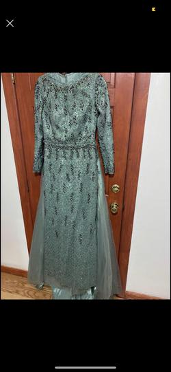 Beautiful long mint teal dress  a skirt attached from the back Green Size 10 Pageant Teal Sleeves Mermaid Dress on Queenly