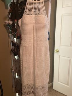 The brand is guess ivory cocktail dress. Very pretty. White Size 4 A-line Dress on Queenly